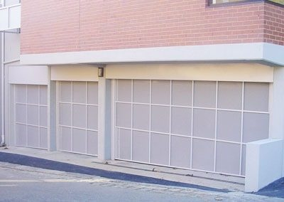 Model COMM_PERF2200 perforated sheeting tilting door