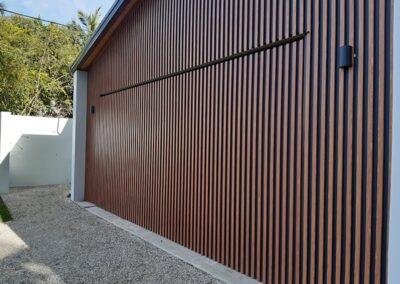 Flush Mount Tilt door fitted with vertical aluminium batten in DecoWood finish