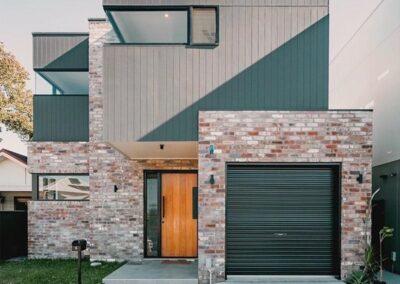 Colorbond green roller door with brick exterior