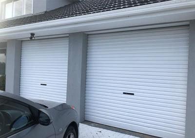 A car in front of garage door